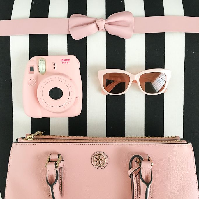 Fujifilm Instax Mini 8 Camera pink, pink bow belt, pink sunglasses, Tory Burch mini Robinson in rose pink, striped accent chair, pink accessories - click the photo for details!