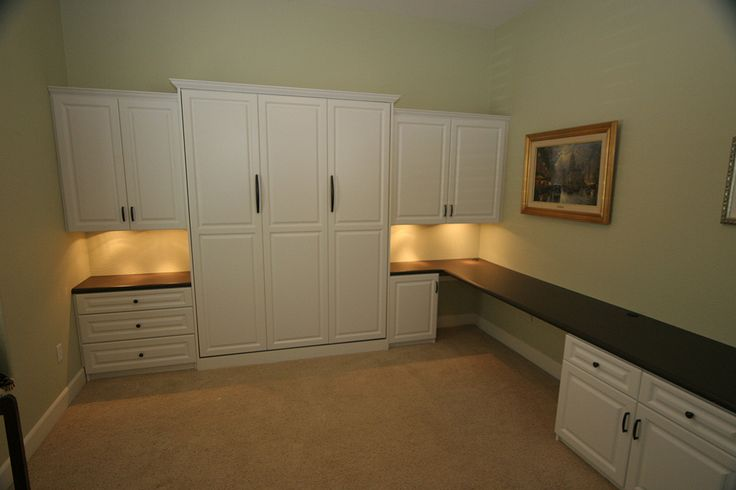 Murphy Bed and home office make a great spare bedroom setup. Love the long desk. http://www.closet-doctor.com/murphy-beds-photo-gallery