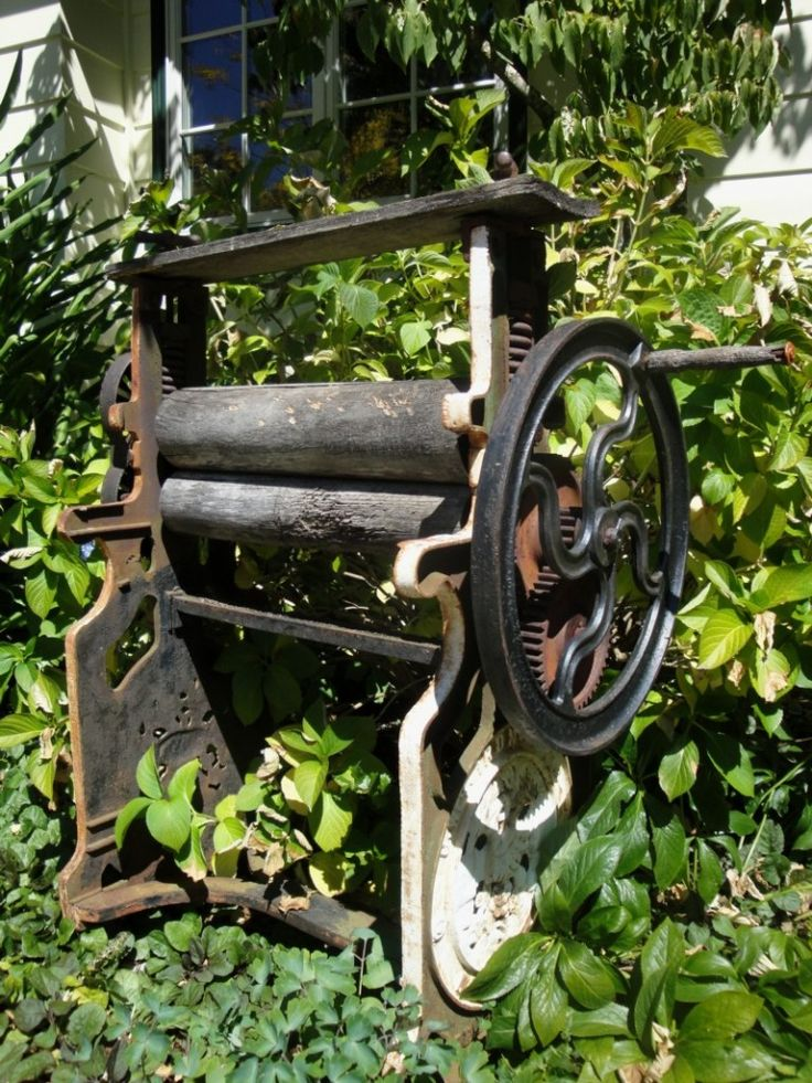 Our-Antique-Laundry-Press-as-Garden-Decor