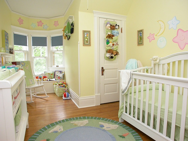 sweet buttery yellow nursery with window seat alcove in turret