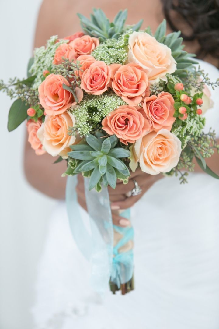 coral roses and green succulents wedding bouquet