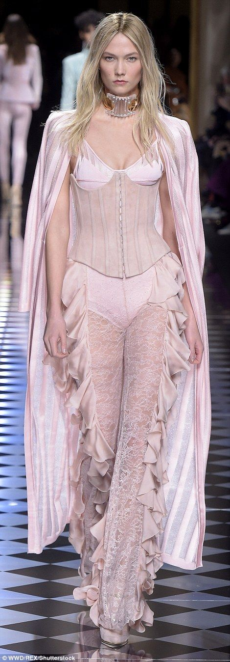 Karlie Kloss rocked the underwear as outerwear trend in a pastel pink corset and see-through lace trousers complete with frills