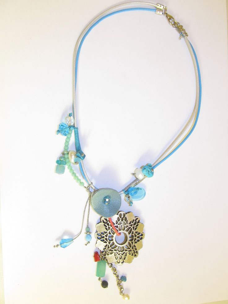 Handmade short leather necklace (1 pc)  Made with silver leather filigree, light blue leather part, leather cords, freshwater pearl, lava, turquoise, semiprecious stones, glass beads and wax cords.