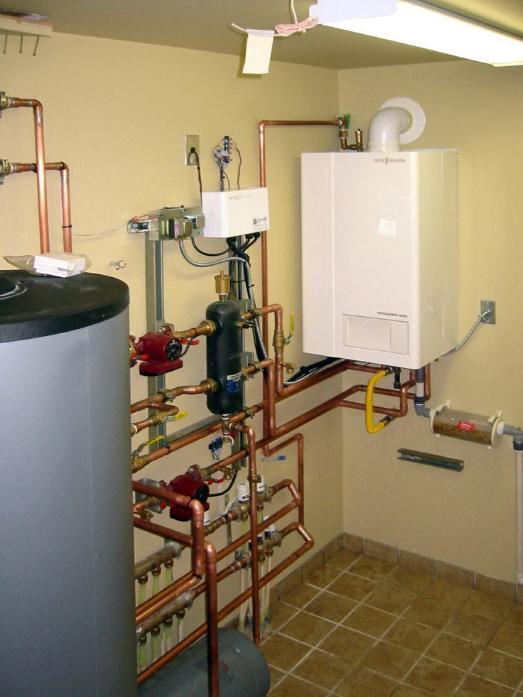 This well-designed mechanical room by Radiant Engineering includes a Viessmann boiler. Order your custom hydronic heating system from radiantengineering.com. #Viessmann