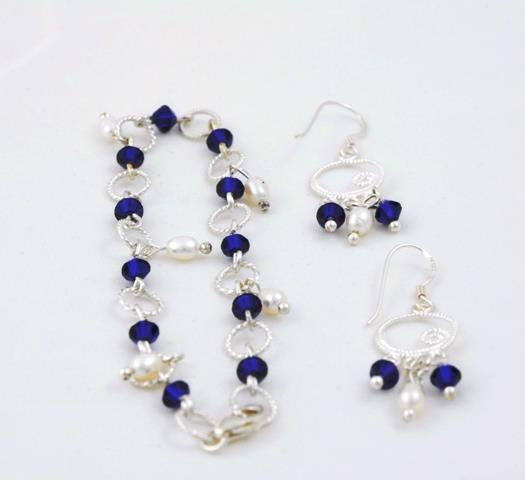 silver bracelet and earrings with pearls and swarovski elements