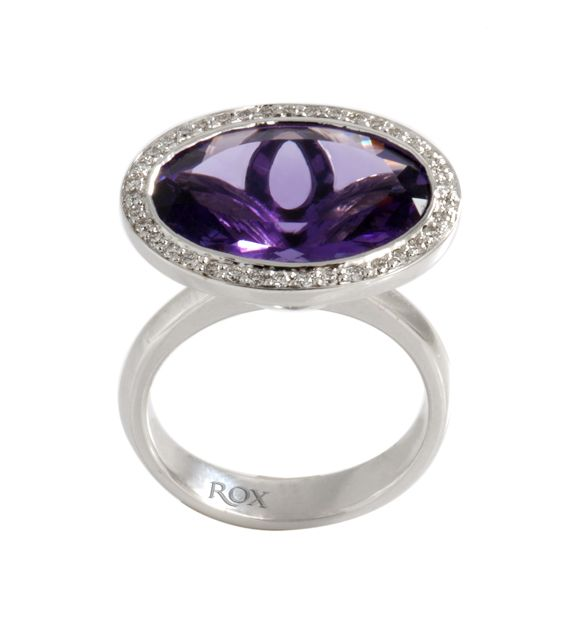 Amethyst ring with Diamond Halo by ROX - Collectors of Amethyst look for depth of colour, and this specimen exhibits an intense, royal purple, which is stunningly framed by the white gold and diamond halo.