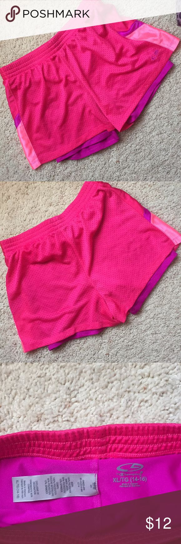 Hot pink Champion workout shorts with spandex Like brand new, barely worn. Mesh hot pink shorts with purple spandex underneath. Girls XL, fits like women's S or XS. G7 by Champion Champion Shorts