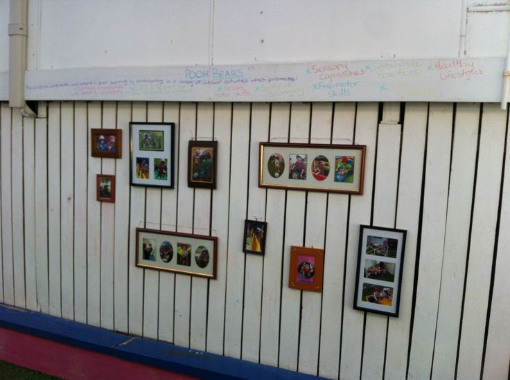 Displaying children's photos outside using old photo frames.