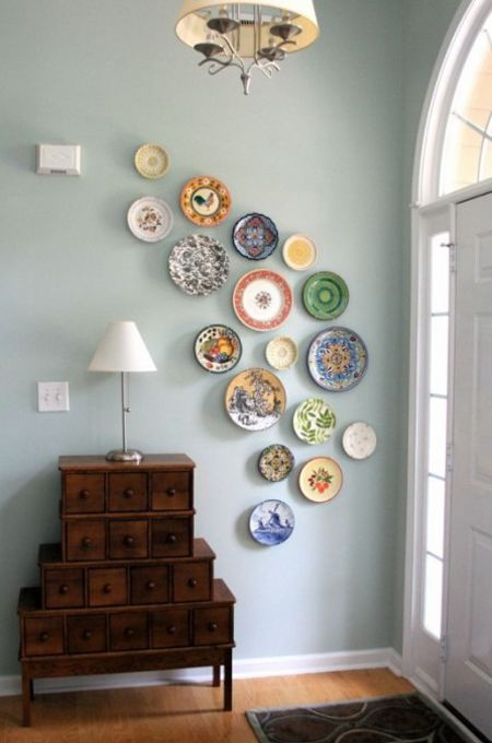 Blue Entrance With Asymmetrical Plate Display // from Arcadian Home Blog//I want to put plates on my walls so badly