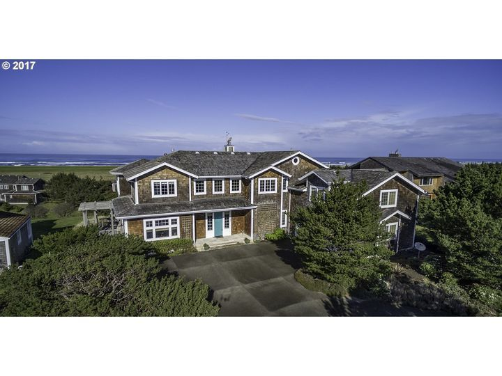 The Highlands Area Residential: If you demand the best, consider this 5000+ sq. ft. home in The Highlands of Gearhart where property owners own the 9 hole golf course and tennis courts. Some of the special features include a great room floor plan, three master suites all with views, Simon and Toney designed kitchen, large office with extensive built-ins, spacious family/media room, gated community and 180 degree views of the Pacific Ocean, Tillamook Head and The Lighthouse.