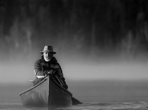Black and white photography lone man and a paddle