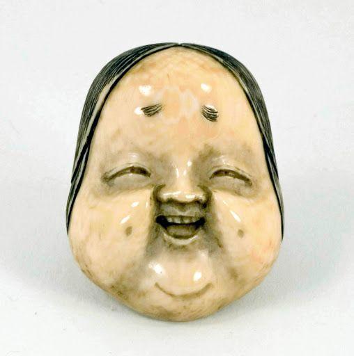 Okame (Ofuku, Otafuku): mask, ivory. Ikko.