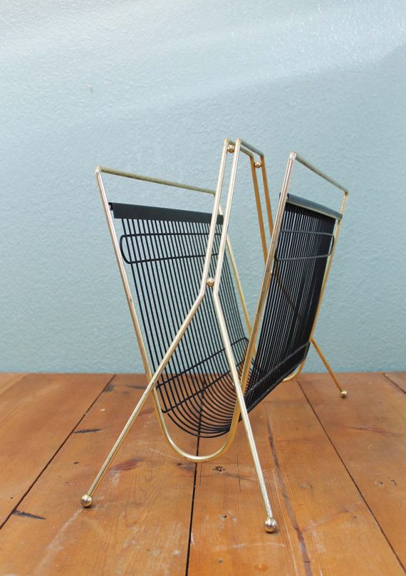This listing is for an awesome Mid-Century magazine rack. Overall it is in great vintage shape. The brass has light tarnishing