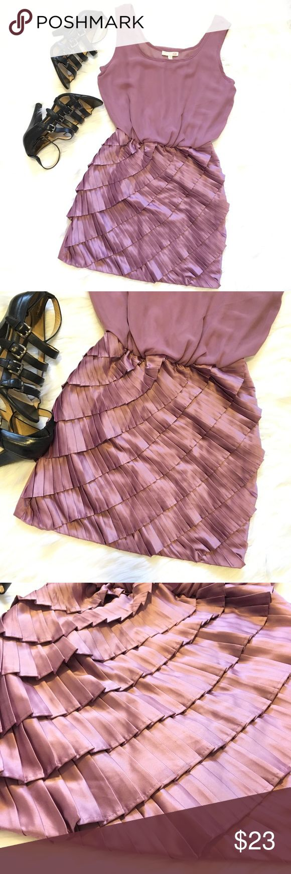 Gianni Bini sleeveless mini blouson ruffle dress Gianni Bini purple lavender pleated ruffle sleeveless mini blouson dress. Size small. Skirt is pleated accordion style in a ruffle layered silhouette with metallic sheen as it moves. The top is a blouson style sleeveless scoop neck solid. Color is slightly darker than lavender but still a soft purple. Great condition. No flaws. Smoke free home. 96% poly 4% spandex. Great for date night, girls night, holiday parties. Add a statement necklace…