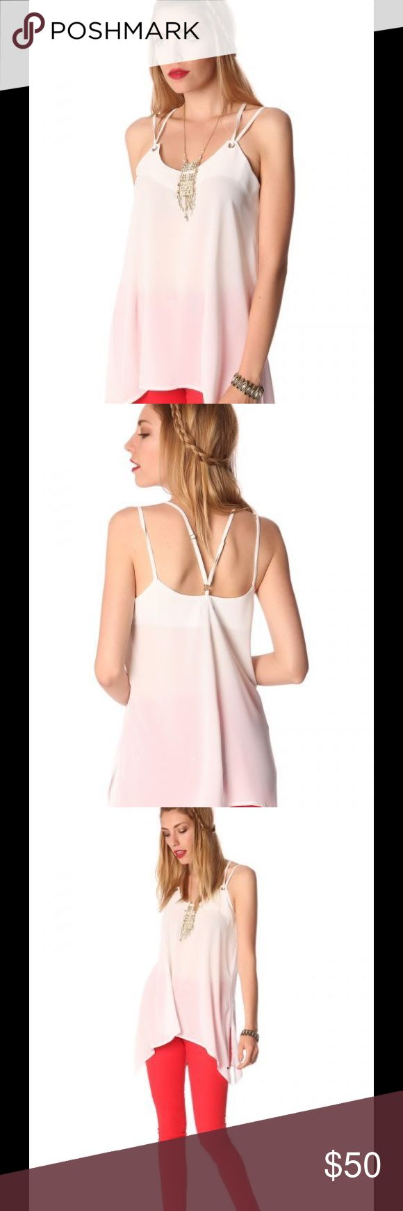 Long White Cami Top Round neck with double straps and round details. Side slits and asymmetrical hem. 100% Polyester Q2 for Fab50Fashions Tops Camisoles