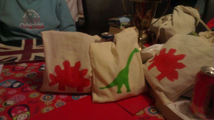 Party Bags - Reusable canvas bag with stencil stegasaurus and brachiosaurus included a craft kit, recipe and Ingredients to make your own playdough, glow whistle and miniature dinosaur with ID card.