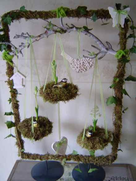 Wrap or glue a frame with moss, decorate with natural elements