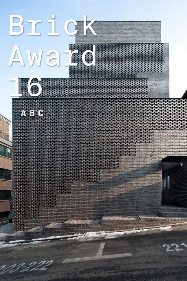 #WienerbergerBrickAward 2016 nominee 32: ABC building, Korea by WISE Architecture, Korea. Correlating with the rather humble and decent design the architects chose black brick as the main building material.  Photographer: Hyo Sook Chin ow.ly/VXAPR