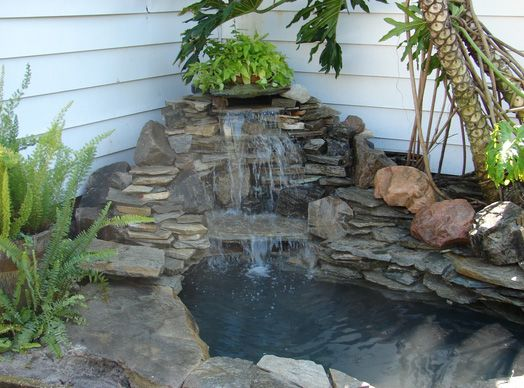 42 best images about waterfalls and ponds on pinterest for Koi fish pond rocks