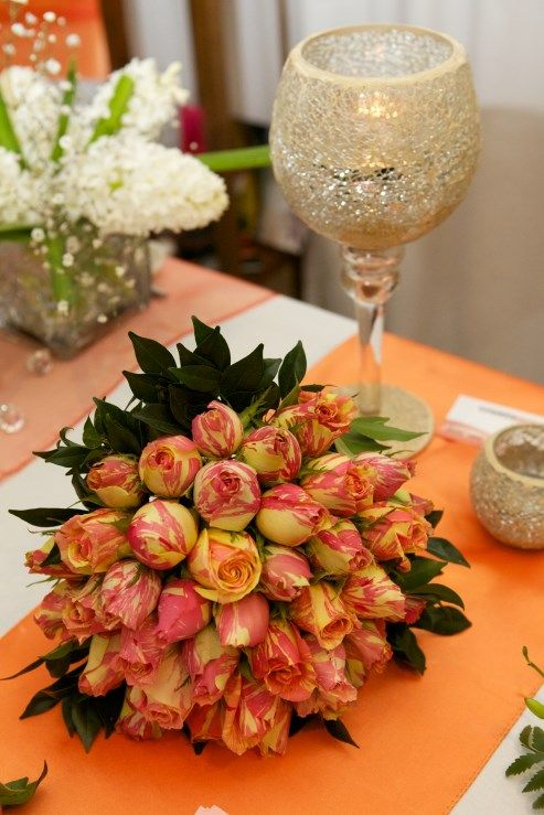Different shades of orange - bouquet by Wendy's Flowers and Event Hire