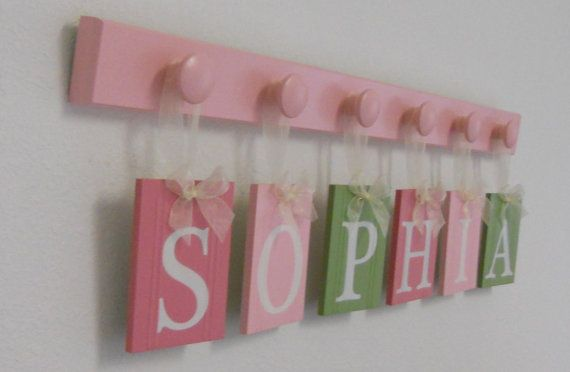 SOPHIA - Wooden Letters Nursery Includes Childrens Names 6 Wood Hooks in Pink and Light Pink and  Light Green. Custom Kids Wall Art. $29.00, via Etsy.
