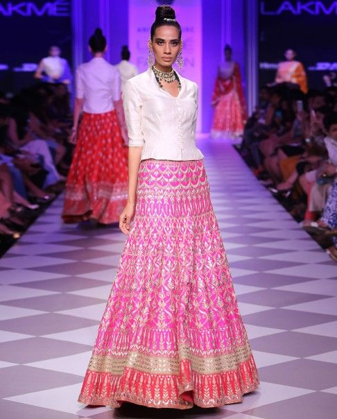 French Fuchsia embroidered Lehenga with intricate light golden thread gotapatti embellishments across. Contrasting stark white bandi top with button up detailing at the front.Wash care: Dry clean only Disclaimer: There might be slight color variation in this item as these images are from the runway