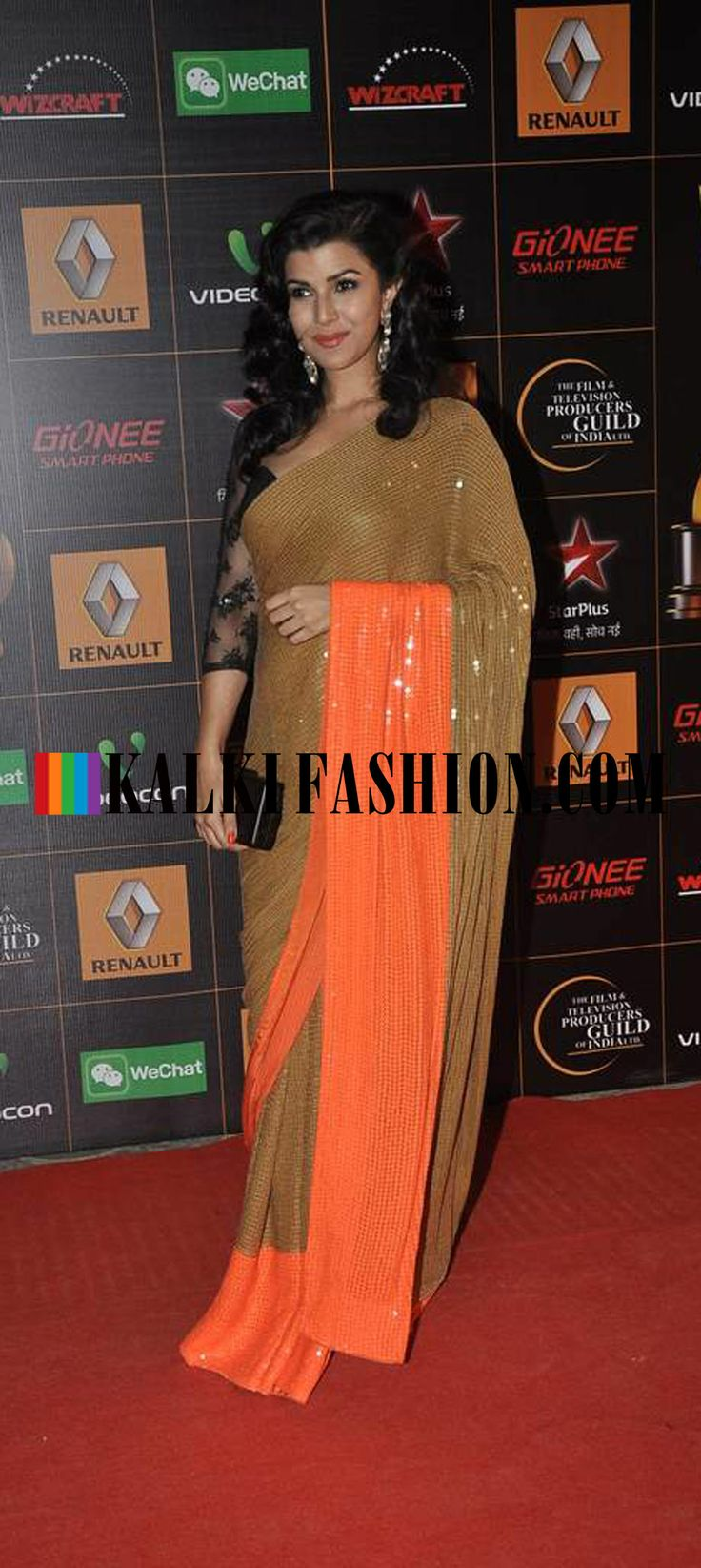 Nimrata Kaur attended the Star Guild Awards 2014 in a gold and orange sequence saree by ATSU