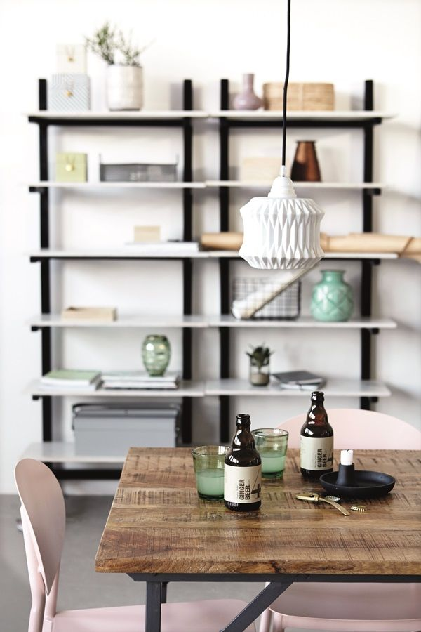 blush walls, industrial light, black and white vase, brass edge of mirror, brass drawer pulls, bright white, rough wood, shiny black, mint green. industrial plus pale colors, plus natural, br yellow mirror in dresser,  wood texture