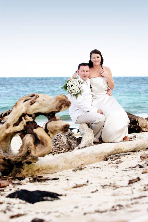 Bride & Groom + blue sea, rocks