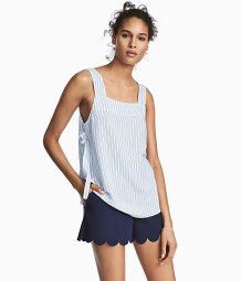 Short, high-waisted shorts in woven fabric with a concealed zip at side, side pockets, and laser-cut, scalloped hems.