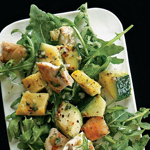 Grilled chicken breasts, summer squash, and baby arugula meet a spicy lime-cilantro dressing in this fresh take on chicken salad.