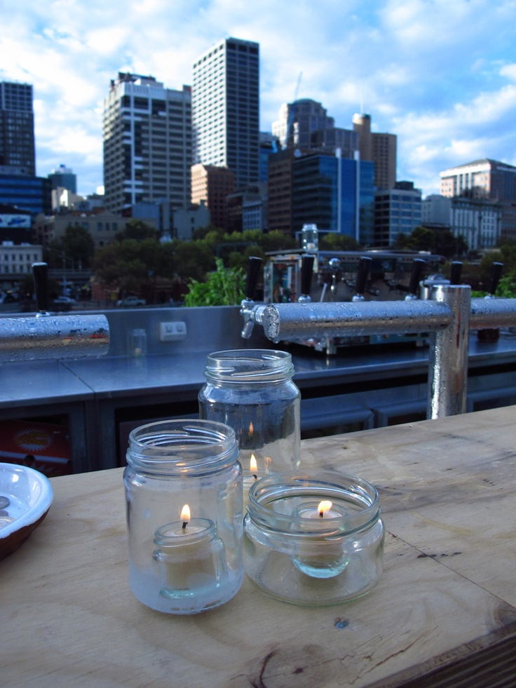 Queen B Joost Jam Jar tealights with the beautiful Melbourne skyline in the background - Greenhouse by Joost Melbourne Food & Wine Fair