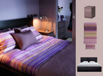 Peaceful bedroom with MALM bed in black/brown and nightstand in purple and PALMILJA quilt cover