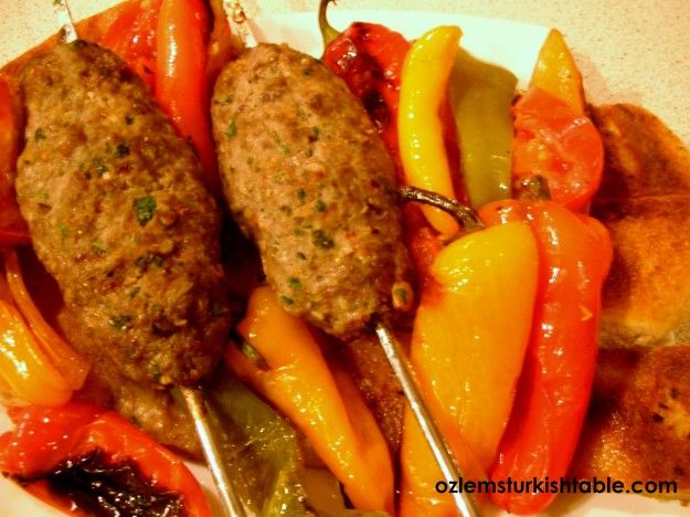 lamb kebabs with pistachio and roasted veg