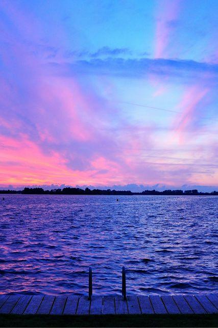 purple sky, little water waves, wooden boardwalk