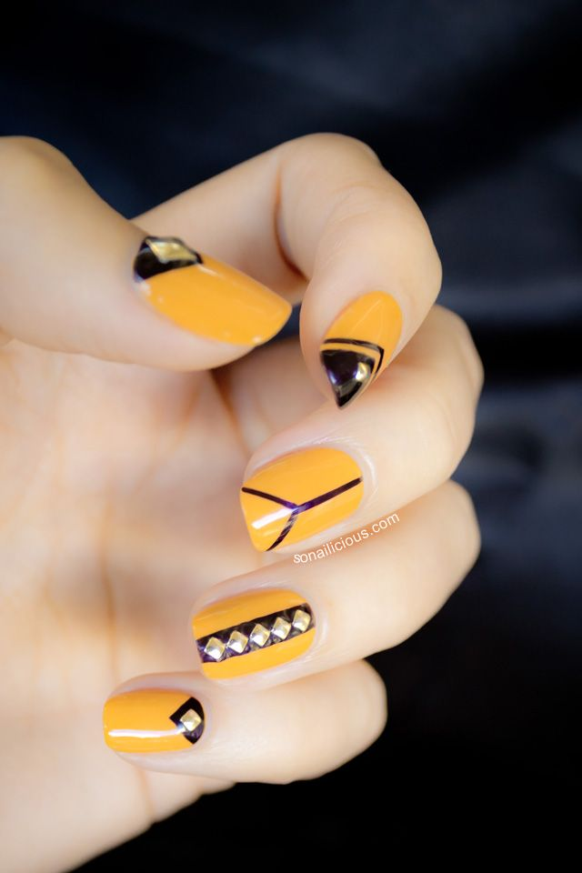 yellow + black studded nails