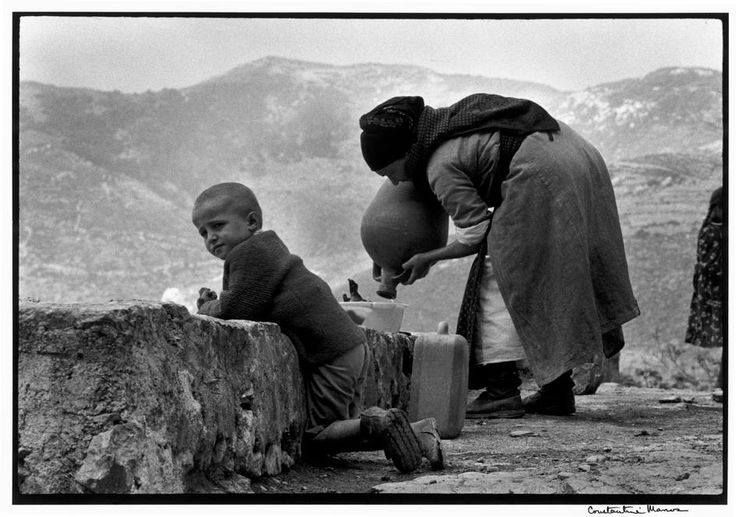 "Constantine Manos - Greece. Karpathos. Olympos. 1964. At the village fountain.. ""A Greek Portfolio"" p.18"