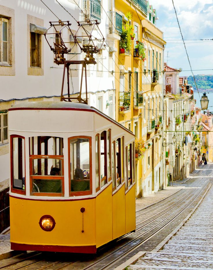 Lisbon's Gloria funicular classified as a national monument opened 1885 located on the west side of the Avenida da Liberdade connects downtown with Bairro Alto.   |   TOP 10 Romantic places to spend your Valentine's Day