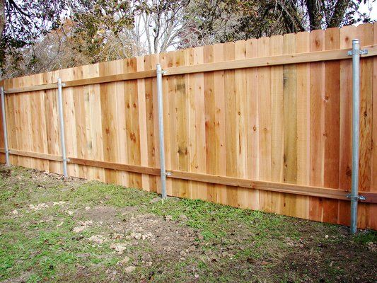 wooden slat fence with metal posts for support wood privacy fence on steel posts western red. Black Bedroom Furniture Sets. Home Design Ideas