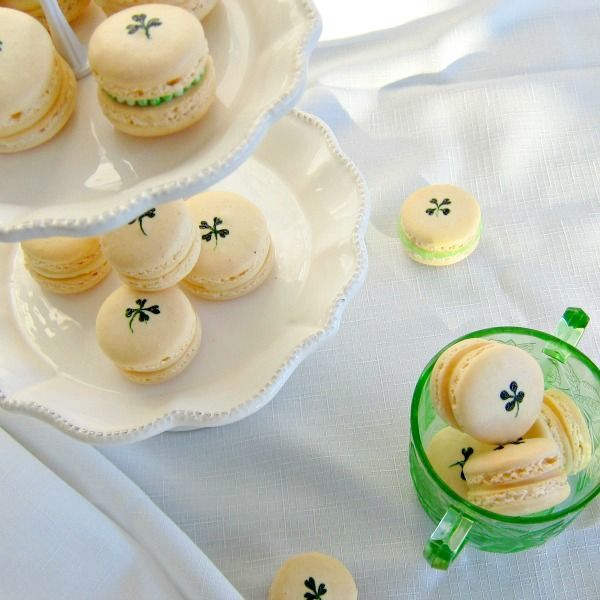 Nutty Irishman Macarons -- the green shamrocks on the shells are adorable! Just add a couple of small dots of gel food coloring and shape with a toothpick!