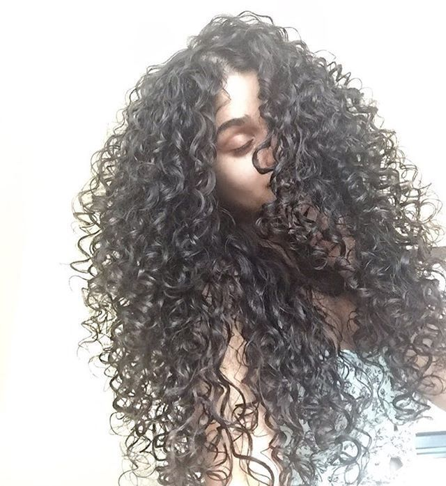 Gorgeous long black curly hair.