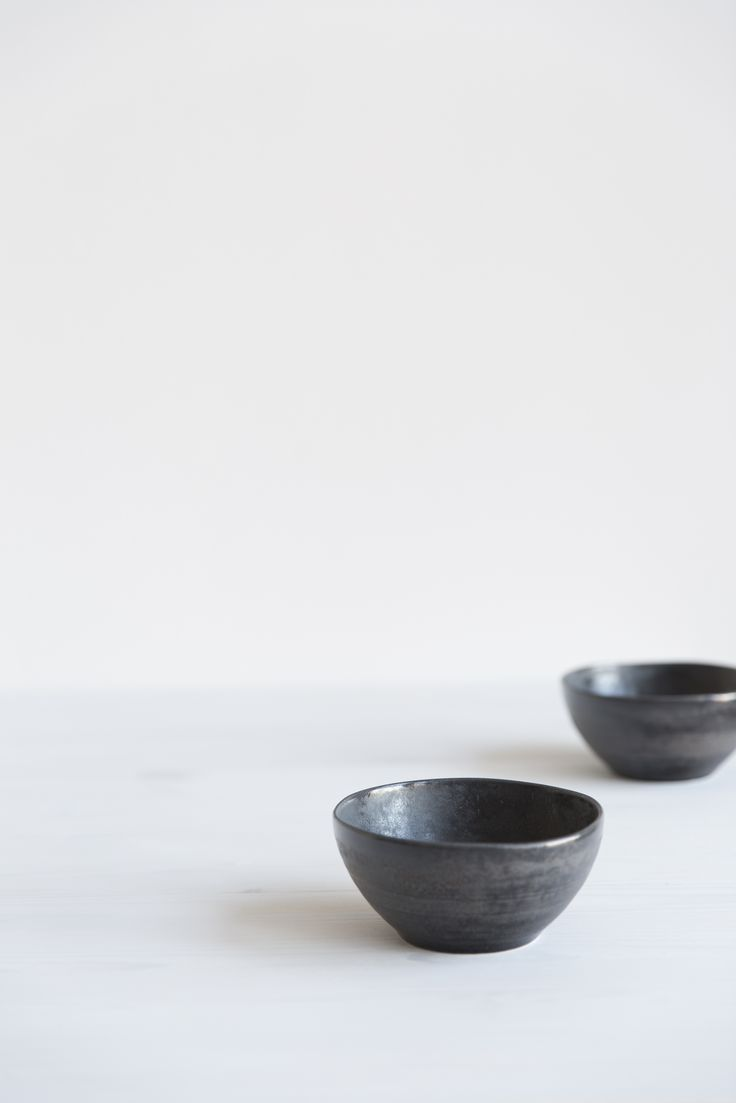 Kivi Bowl | Designed by Anu Pentik, this bowl is a part of Kivi (Stone) tableware series that brings firmness and minimalism to your table setting with its dark essence. Interspersed with the sweet colour scheme of Kallio astiasto, Kivi catches your eye in a magnificent way. Made in Posio, Finnish Lapland.