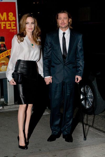 Angelina Jolie and a cane-holding Brad Pitt at Film Critics Awards