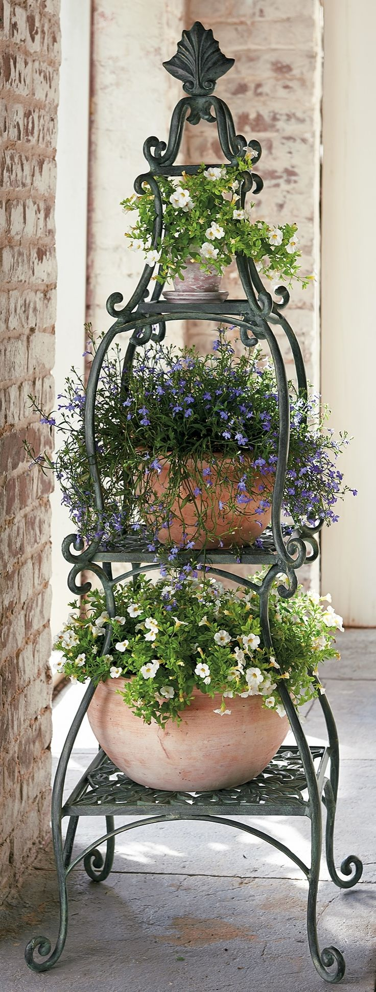 This refined Florentine Garden Collection enhances your outdoor space with delicate scrollwork and a hand-applied verdigris finish with gold highlights.