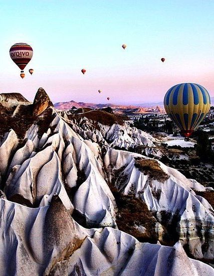 A trip to Cappadocia will leave you feeling as though you've landed on the moon. Home to ancient underground settlements and outstanding examples of Byzantine art, many of the 'fairy chimneys' are still inhabited today. Float away with hundreds of hot air balloons over the dreamy and surreal landscape.