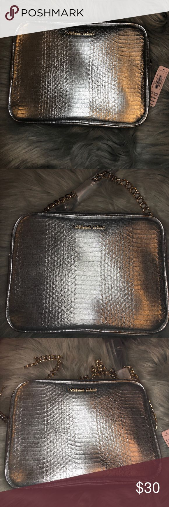 NWT Victoria's Secret silver shoulder bag Silver cross body Victoria's Secret bag is ready to party just as much as you! The faux reptile silver skin with a chain strap and tassel zipper is exactly what you need for your next out...or your friend's. Price is negotiable so make me an offer. Victoria's Secret Bags Crossbody Bags