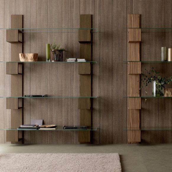 Infinity Bookcase by Compar  This bookcase has an original and unique design. It is made out of wood and glass ant is therefore beautiful, light and resistant.  You can use it for books but also for any other piece or ornament you may want.
