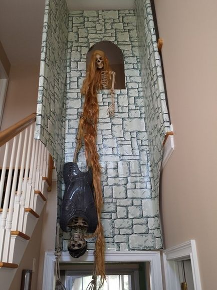 Rapunzel prop - cardboard? With dollar store hair extensions. Smart!