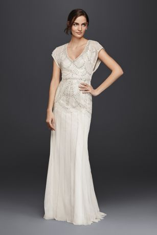 Jenny Packham's signature beading creates a vintage-inspired pattern across the short-sleeve blouson bodice of this mesh sheath wedding dress. The graceful design is fitted through the hips, then subtly flares down to the floor.  Wonder by Jenny Packham, exclusively at David's Bridal  Polyester  Sweep train  Back zipper; fully lined  Dry clean  Imported