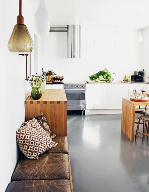 a cushioned bench in the kitchen (or set of 3 small storage ottomans, anywhere). In Malene's house in Malmö.